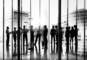 Silhouettes of Business People Working and Cityscape